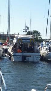 Båt med slagsida Tallebryggan Karlskrona